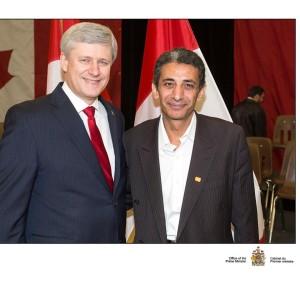 مدحت عويضة مع هاربر رئيس الحكومة الكندية