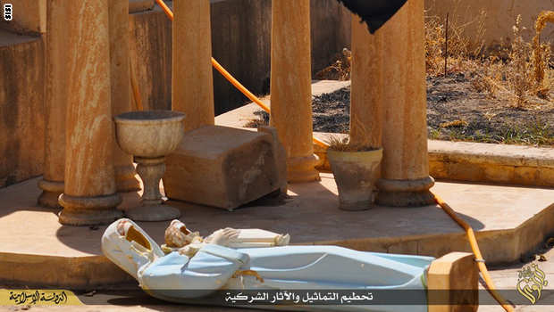 ISIS removes crosses and manifestations of polytheism
