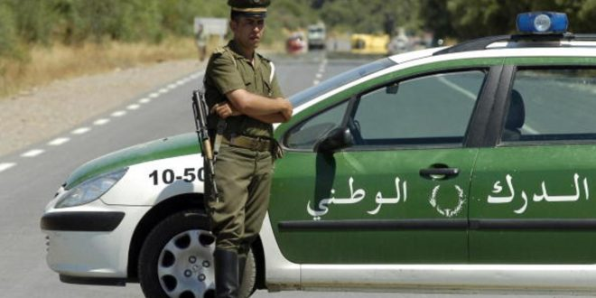 Lakhdaria, ALGERIA: An Algerian policeman stands guard as security forces block the road to Lakhdaria, 70 kilometres (45 miles) southeast of Algiers, where a suicide bomber rammed an explosives-packed truck into an Algerian barracks 11 July 2007, killing eight soldiers, according to security sources. The attack took place just a few hours before a major African sporting event started in the capital. A major security operation was launched around Lakhdaria, in parallel to the huge precautions taken for the All-Africa Games which involve 8,000 athletes from more than 20 countries. AFP PHOTO/FETHI BELAID (Photo credit should read FETHI BELAID/AFP/Getty Images)