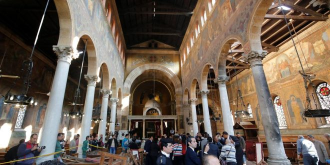 Egyptian security officials and investigators inspect the scene following a bombing inside Cairo's Coptic cathedral in Egypt